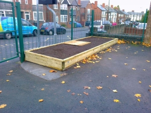 Planter with drain cover access panel