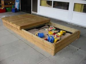 Sandbox with sliding lid
